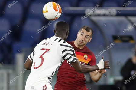 Roma's Henrikh Mkhitaryan, right, heads the ball past Manchester United's Eric Bailly during the Europa League semifinal, second leg soccer match between Roma and Manchester United at Rome's Olympic stadium, Italy