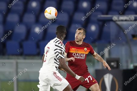 Roma's Henrikh Mkhitaryan, right, is challenged by Manchester United's Eric Bailly during the Europa League semifinal, second leg soccer match between Roma and Manchester United at Rome's Olympic stadium, Italy