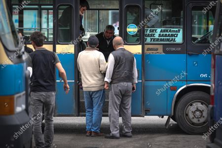 Bus drivers seen having a chat during curfew. After an increase in COVID-19 cases in Turkey, President Recep Tayyip Erdogan declared a 17 day curfew after the cabinet meeting on April 29.