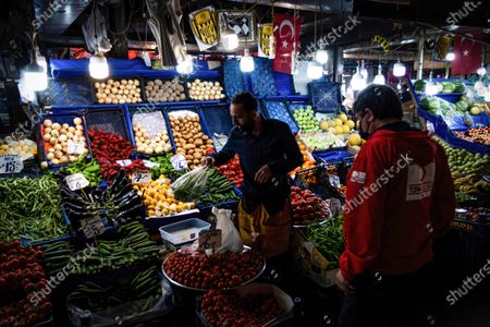 A man wearing a face mask works at a grocery store during curfew hours.After an increase in COVID-19 cases in Turkey, President Recep Tayyip Erdogan declared a 17 day curfew after the cabinet meeting on April 29.
