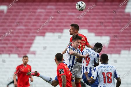Stock Picture of Benfica's Haris Seferovic (up) in action with FC Porto's Uribe (down) during the Portuguese First League Soccer match Benfica vs FC Porto held at Luz Stadium, in Lisbon, Portugal, 06 May 2021.