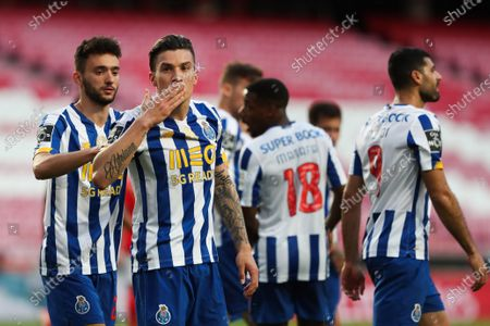 FC Porto's Mateus Uribe celebrates with his teammates after scoring during the Portuguese First League Soccer match Benfica vs FC Porto held at Luz Stadium, in Lisbon, Portugal, 06 May 2021.