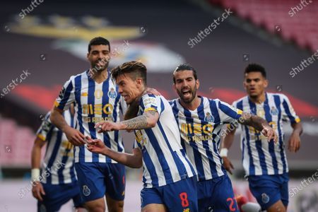 FC Porto's Mateus Uribe (C) celebrates with his teammates after scoring during the Portuguese First League Soccer match Benfica vs FC Porto held at Luz Stadium, in Lisbon, Portugal, 06 May 2021.