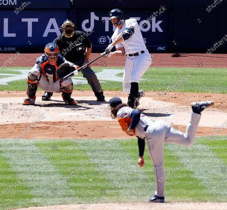 New York Yankees designated hitter Giancarlo Stanton connects on a solo home run in the third inning off a pitch from Houston Astros starting pitcher Lance McCullers Jr. during their MLB game in the Bronx, New York, USA, 06 May 2021.