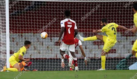 Stock Photo of Villareal's Raul Albiol kicks the ball during the Europa League semifinal second leg soccer match between Arsenal and Villarreal at the Emirates stadium in London, England