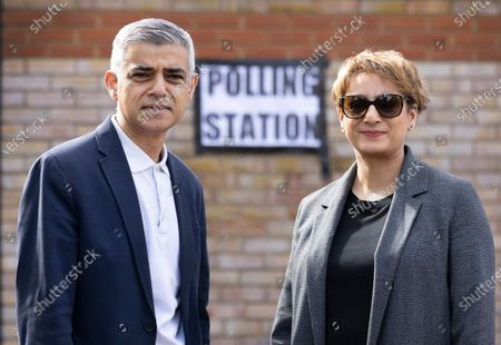 Mayor of London Sadiq Khan stands with his wife Saadiya outside their local polling station on election day in south London. Local and mayoral elections are taking place in the England, with National Assembly elections in Wales and Scotland.