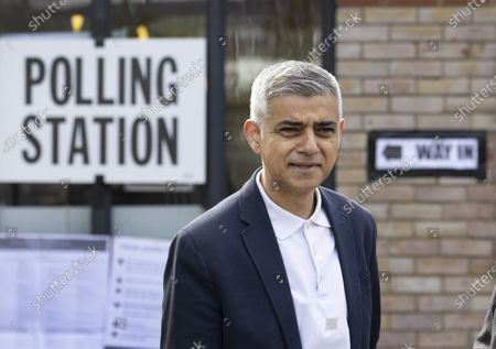 Mayor of London Sadiq Khan stands outside his local polling station on election day in south London. Local and mayoral elections are taking place in the England, with National Assembly elections in Wales and Scotland.