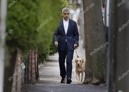 Mayor of London Sadiq Khan walks with his dog Luna to his local polling station on election day in south London. Local and mayoral elections are taking place in the England, with National Assembly elections in Wales and Scotland.