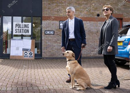 Mayor of London Sadiq Khan stands with his wife Saadiya and their dog Luna outside their local polling station on election day. Local and mayoral elections are taking place in the England, with National Assembly elections in Wales and Scotland.