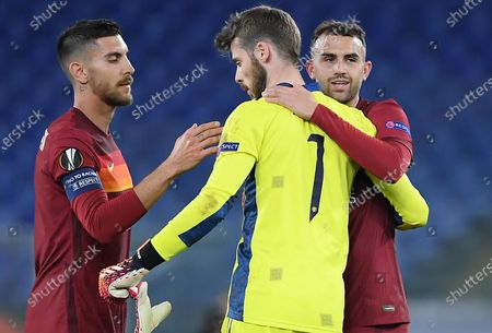 AS Roma's players Lorenzo Pellegrini (L) and Borja Mayoral (R) with Manchester United's goalkeeper David de Gea (C) at the end of the UEFA Europa League semifinal second leg soccer match between AS Roma and Manchester United at Olimpico stadium in Rome, Italy, 06 May 2021.