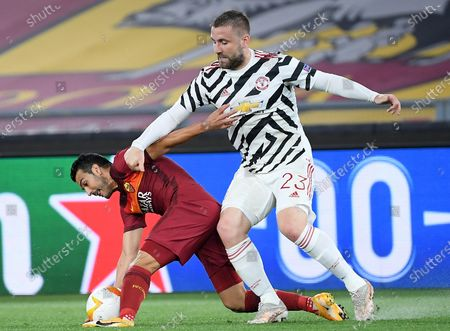 Stock Picture of AS Roma's Pedro Rodriguez (L) vies for the ball with Manchester United's Luke Shaw during the UEFA Europa League semifinal second leg soccer match between AS Roma and Manchester United at Olimpico stadium in Rome, Italy, 06 May 2021.