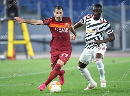AS Roma's Henrikh Mkhitaryan (L) vies for the ball with Manchester United's Eric Bailly  during the UEFA Europa League semifinal second leg soccer match between AS Roma and Manchester United at Olimpico stadium in Rome, Italy, 06 May 2021.
