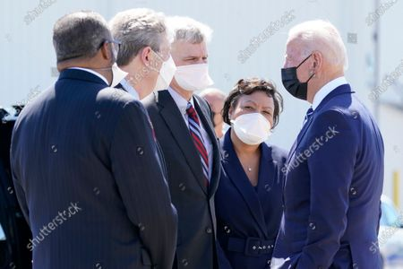 Stock Picture of President Joe Biden greets, from left, Rep.-elect Troy Carter, D-La., Sen. John Kennedy, R-La., Sen. Bill Cassidy, R-La., and New Orleans Mayor LaToya Cantrell upon arrival at Louis Armstrong New Orleans International Airport, in Kenner, La