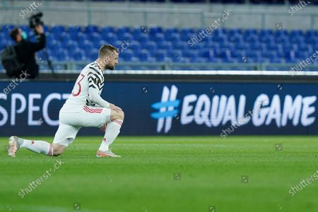 Luke Shaw of Manchester United takes a knee in support of the Black Lives Matter movement during the UEFA Europa League Semi-Final match between AS Roma and Manchester United at Stadio Olimpico, Rome, Italy on 6 May 2021.