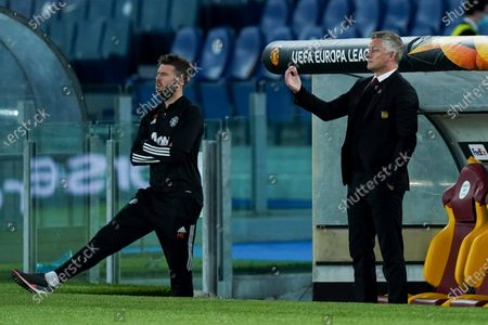 Ole Gunnar Solskjaer manager of Manchester United and Michael Carrick of Manchester United during the UEFA Europa League Semi-Final match between AS Roma and Manchester United at Stadio Olimpico, Rome, Italy on 6 May 2021.