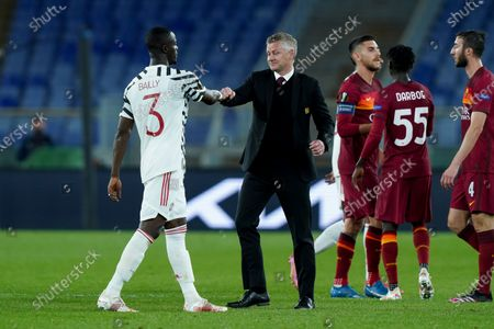 Stock Image of Eric Bailly of Manchester United shakes hand to Ole Gunnar Solskjaer manager of Manchester United during the UEFA Europa League Semi-Final match between AS Roma and Manchester United at Stadio Olimpico, Rome, Italy on 6 May 2021.