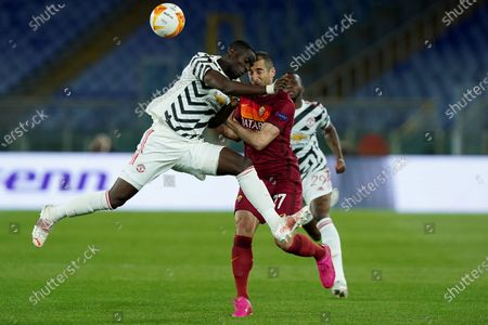 Eric Bailly of Manchester United and Henrikh Mkhitaryan of AS Roma compete for the ball during the UEFA Europa League Semi-Final match between AS Roma and Manchester United at Stadio Olimpico, Rome, Italy on 6 May 2021.