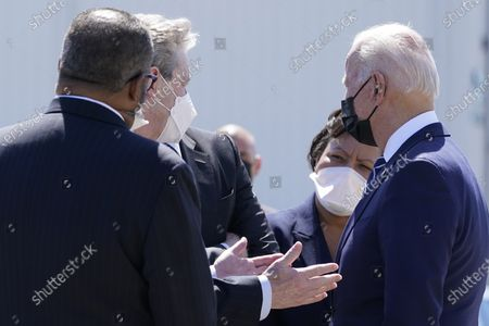 President Joe Biden greets, from left, Rep.-elect Troy Carter, D-La., Sen. John Kennedy, R-La., Sen. Bill Cassidy, R-La., and New Orleans Mayor LaToya Cantrell upon arrival at Louis Armstrong New Orleans International Airport, in Kenner, La