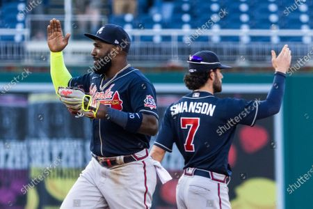 Atlanta Braves left fielder Marcell Ozuna (L) and Atlanta Braves shortstop Dansby Swanson (R) celebrate after sweeping a series against the Washington Nationals at Nationals Park in Washington, DC, USA, 06 May 2021.