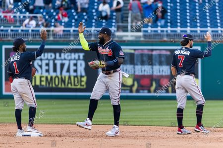 Atlanta Braves second baseman Ozzie Albies (L), Atlanta Braves left fielder Marcell Ozuna (C) and Atlanta Braves shortstop Dansby Swanson (R) celebrate after sweeping a series against the Washington Nationals at Nationals Park in Washington, DC, USA, 06 May 2021.