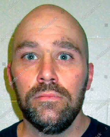 Stock Picture of Provided by the Nevada Department of Corrections shows convicted mass murderer Zane Floyd, 45, an inmate at Ely State Prison. A federal judge said, he might issue an order to block a bid by prosecutors to have a state judge set a date as early as next month for Nevada's first execution in 15 years. U.S. District Judge Richard Boulware II told officials he'll need time to determine if the as-yet-undisclosed drugs and lethal injection process that prison officials want to use to put convicted mass murderer Zane Michael Floyd to death would be constitutionally humane