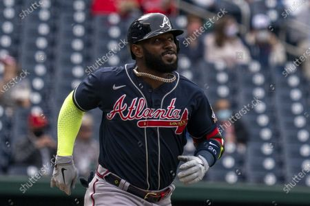 Atlanta Braves left fielder Marcell Ozuna runs to first base against the Washington Nationals in the first inning at Nationals Park in Washington, DC on Thursday, May 6 2021.
