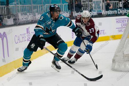 Stock Photo of San Jose Sharks left wing Evander Kane (9) skates against Colorado Avalanche defenseman Ryan Graves (27) during an NHL hockey game in San Jose, Calif