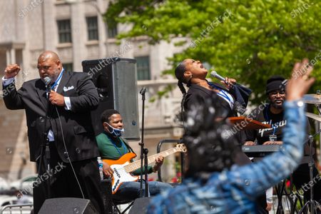 Gospel singer Robin Sugar Williams performs at a rally for mothers of children killed by police, with backup vocals by Reverend George Gilbert (left).  The mothers demand justice, accountability, and a complete overhaul of policing in the United States.