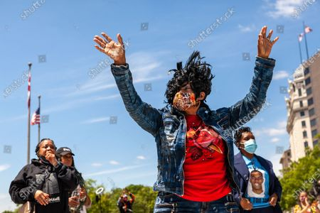 Brenda Joyner, mother of Trey Joyner, who was killed by police, enjoys a performance by gospel singer Robin Sugar Williams during a rally in which mothers of children who died at the hands of police demand justice, accountability, and a complete overhaul of policing in the United States.