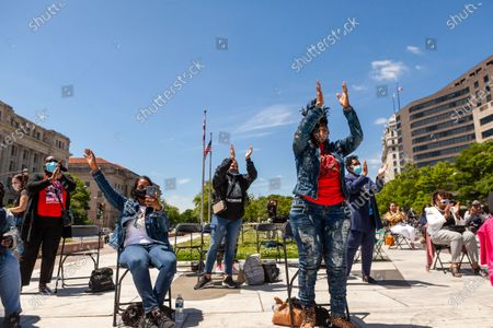 Mothers of children killed by police, enjoy a performance by gospel singer Robin Sugar Williams during a rally in which they demand justice, accountability, and a complete overhaul of policing in the United States.  Left to right: Greta Willis (Kevin Cooper), Darlene Cain (Dale Graham), Rhanda Dormeus (Korryn Gaines), Brenda Joyner (Trey Joyner), Valerie Bell (Sean Bell), Gwen Carr (Eric Garner).