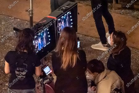 Actress Lily Collins is seen filming on set of series two of 'Emily in Paris'