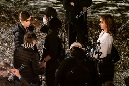Actress Lily Collins and Philippine Leroy-Beaulieu (R) are seen filming on set of series two of 'Emily in Paris'