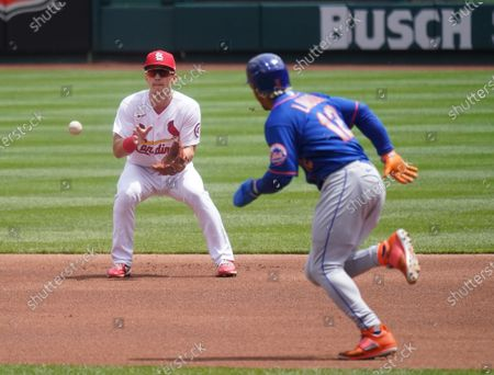 St. Louis Cardinals Tommy Edman fields a baseball off the bat of New York Mets Michael Conforto as Mets Francisco Lindor takes off for second base in the first inning at Busch Stadium in St. Louis on Thursday, May 6, 2021. Lindor was out at second while Conforto was safe at first base