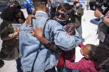"""Friends and family are reunited after separation due to COVID-19 at """"CLEAR Connects: A Day of Families"""" at MetLife Stadium, in East Rutherford, N.J"""