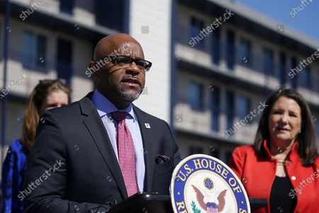 Rep. Diana DeGette, D-Colo., back, looks on Denver Mayor Michael Hancock makes a point during a news conference outside a shuttered Travelodge Hotel that will be purchased by the city to convert to a residence for people experiencing homelessness, in northeast Denver. Rep. DeGette will seek $2 million in federal funding to help purchase the site. DeGette, like each member of Congress, is able to seek funding for 10 projects through the Community Project Funding Requests