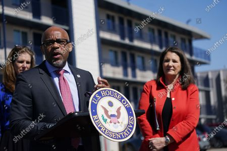 Rep. Diana DeGette, D-Colo., back, looks on as Denver Mayor Michael Hancock makes a point during a news conference outside a shuttered Travelodge Hotel that will be purchased by the city to convert to a residence for people experiencing homelessness, in northeast Denver. Rep. DeGette will seek $2 million in federal funding to help purchase the site. DeGette, like each member of Congress, is able to seek funding for 10 projects through the Community Project Funding Requests