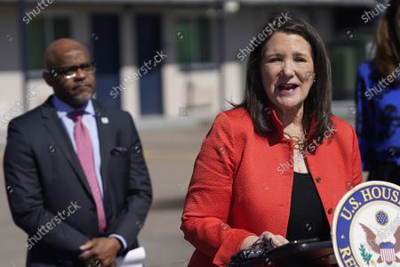 Rep. Diana DeGette, D-Colo., front, makes a point as Denver Mayor Michael Hancock looks on during a news conference outside a shuttered Travelodge Hotel that will be purchased by the city to convert to a residence for people experiencing homelessness, in northeast Denver. Rep. DeGette will seek $2 million in federal funding to help purchase the site. DeGette, like each member of Congress, is able to seek funding for 10 projects through the Community Project Funding Requests
