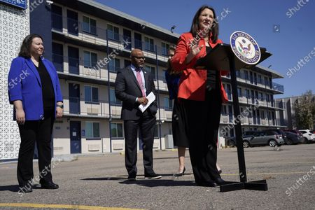 Rep. Diana DeGette, D-Colo., front, makes a point as Denver Mayor Michael Hancock, back right, and Britta Fisher, executive director of the City of Denver's Department of Housing Stability, look on during a news conference outside a shuttered Travelodge Hotel that will be purchased by the city to convert to a residence for people experiencing homelessness, in northeast Denver. Rep. DeGette will seek $2 million in federal funding to help purchase the site. DeGette, like each member of Congress, is able to seek funding for 10 projects through the Community Project Funding Requests