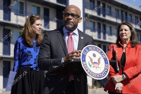 Denver Mayor Michael Hancock, front, makes a point as Christina Carlson, chief executive officer of Urban Peak, bakc left, and U.S. Rep. Diana DeGette, D-Colo., look on during a news conference outside a shuttered Travelodge Hotel that will be purchased by the city to convert to a residence for people experiencing homelessness, in northeast Denver. Rep. DeGette will seek $2 million in federal funding to help purchase the site. DeGette, like each member of Congress, is able to seek funding for 10 projects through the Community Project Funding Requests