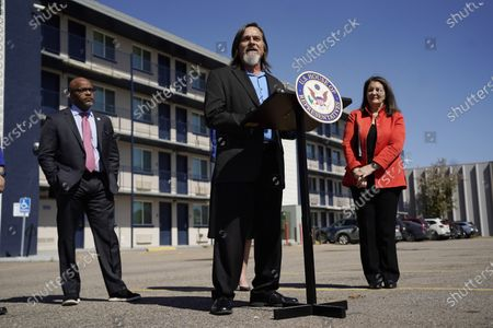 Rep. Diana DeGette, D-Colo., back right, and Denver Mayor Michael Hancock, back left, look on as John Parvensky, chief executive officer of the Colorado Coalition for the Homeless, makes a point during a news conference outside a shuttered Travelodge Hotel that will be purchased by the city to convert to a residence for people experiencing homelessness, in northeast Denver. Rep. DeGette will seek $2 million in federal funding to help purchase the site. DeGette, like each member of Congress, is able to seek funding for 10 projects through the Community Project Funding Requests