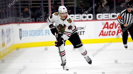 Chicago Blackhawks' Patrick Kane (88) brings the puck up the ice against the Carolina Hurricanes during the third period of an NHL hockey game in Raleigh, N.C