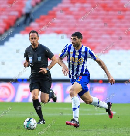 Mehdi Taremi of FC Porto in action during the Liga NOS match between SL Benfica and FC Porto at Estadio da Luz on May 6, 2021 in Lisbon, Portugal.