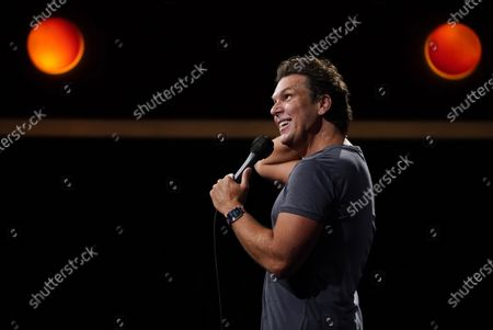 Stock Photo of Comedian Dane Cook performs at the re-opening of the Laugh Factory comedy club, in Los Angeles. The club has been closed to live audiences since March 2020 due to the COVID-19 pandemic
