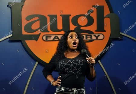 Comedian Sherri Shepherd performs at the re-opening of the Laugh Factory comedy club, in Los Angeles. The club has been closed to live audiences since March 2020 due to the COVID-19 pandemic