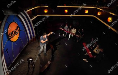Comedian Dane Cook performs to audience members at the re-opening of the Laugh Factory comedy club, in Los Angeles. The club has been closed to live audiences since March 2020 due to the COVID-19 pandemic