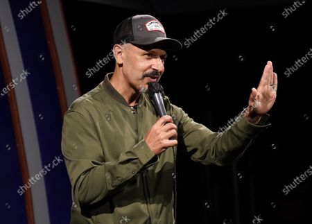 Comedian Maz Jobrani performs at the re-opening of the Laugh Factory comedy club, in Los Angeles. The club has been closed to live audiences since March 2020 due to the COVID-19 pandemic