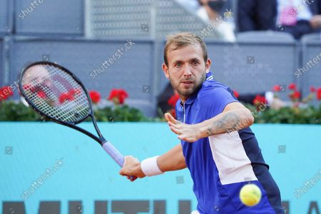 Daniel Evans of Great Britain in action during in his round of 16 match against Alexander Zverev of Germany on day eight of the Mutua Madrid Open tennis tournament at La Caja Magica on May 06, 2021 in Madrid, Spain.