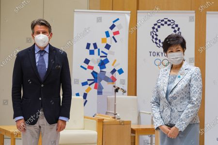 Lord Sebastian Coe President of World Athletics (L) and Tokyo Governor Yuriko Koike (R) poses for photographers before a meeting