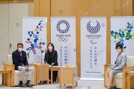 Lord Sebastian Coe President of World Athletics (L) awaits a meeting with Tokyo Governor Yuriko Koike (R)