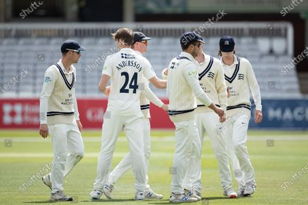 Stock Image of Martin Andersson, Middlesex CCC congratulated by team mates following the dismissal of Taylor during Middlesex CCC vs Gloucestershire CCC, LV Insurance County Championship Group 2 Cricket at Lord's Cricket Ground on 7th May 2021